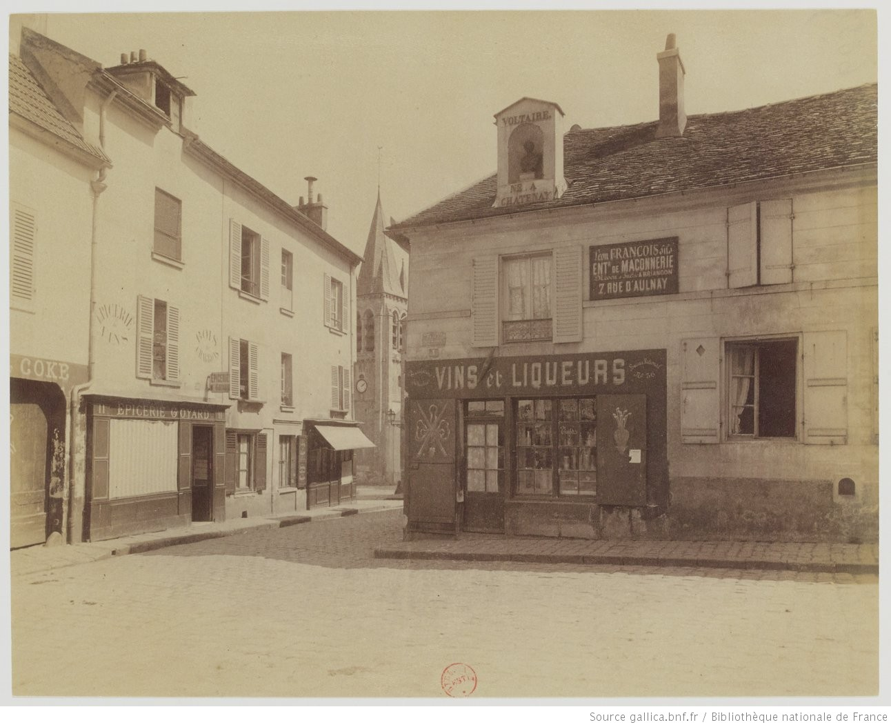 Photograph taken by Eugène Atget in Châtenay in 1901. Note the niche on the roof with a bust of Voltaire and the words 'Voltaire né à Chatenay'. Source: http://gallica.bnf.fr/ark:/12148/btv1b105194234/f1.item