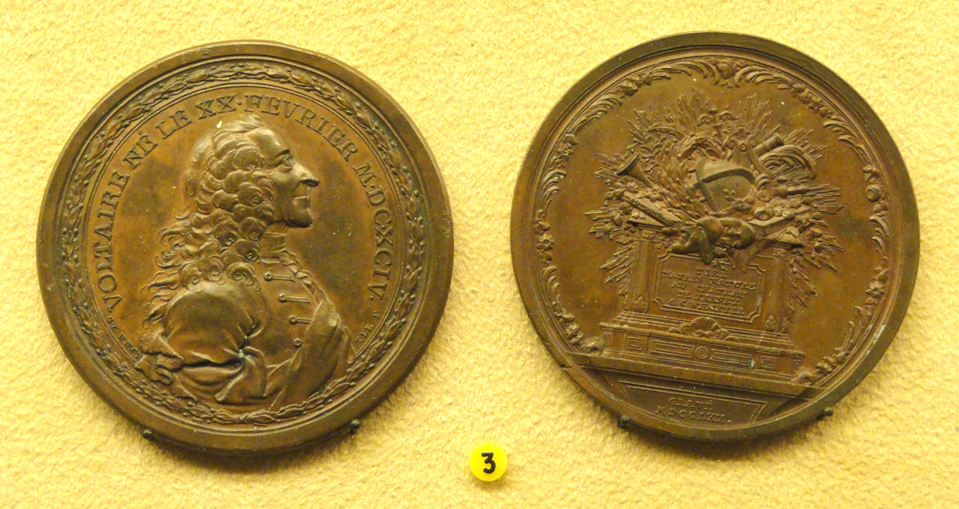 Waechter's 1770 portrait medal of Voltaire gives his date of birth as 'le XX février MDCXCIV' (National Museum of Finland). Voltaire objected to the long pointy nose (letter to Collini of 4 September 1770). Source: https://commons.wikimedia.org/wiki/File:F._M._Voltaire,_France,_1770,_G._C._Waechter_-_National_Museum_of_Finland_-_DSC04062.JPG